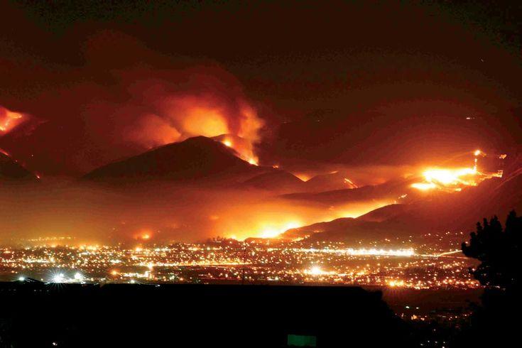 Northeastern San Bernardino, California, as the wildfires light up the night,