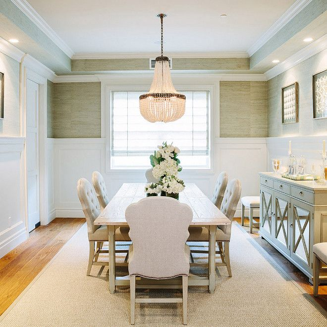 White And Gray Dining Room Features Upper Walls Clad In Grasscloth Lower Wainscoting Lined With A Mirrored Buffet Cabinet
