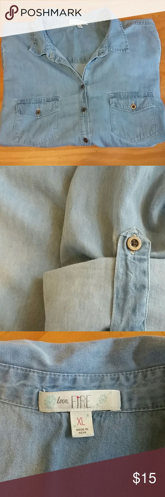 Womens chambray blouse from the Buckle Store Excellent condition. Sleeves can be folded and buttoned up or left long. Love Fire  Tops Button Down Shirts