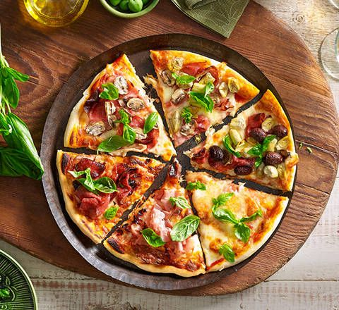 Traditional Italian pizza: Embrace the delightful fresh flavours of Italy with a simple homemade pizza – sometimes less is more!
