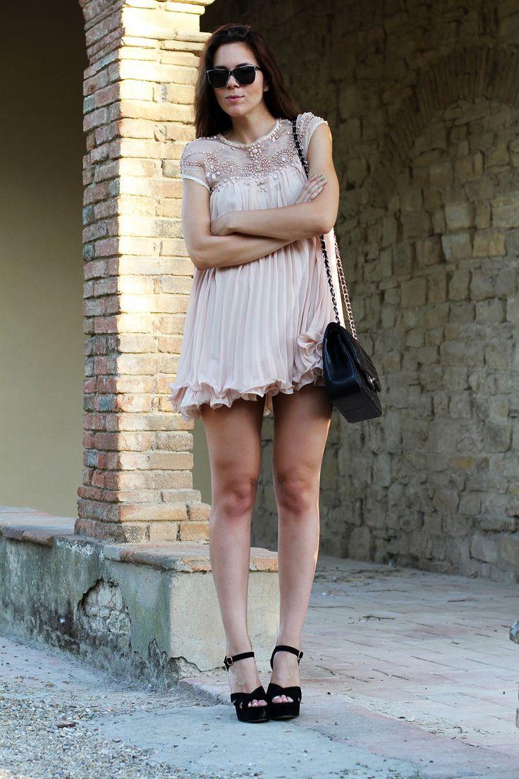 Pink minidress, black heels and a black Chanel bag