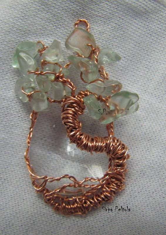 Tree Of Life- Copper Drop Copper wire and greenish glass chip beads wrapped into a tree shape form around a 4 cm long, faceted glass crystal bead. This is my new favourite: loving the color combination. <3