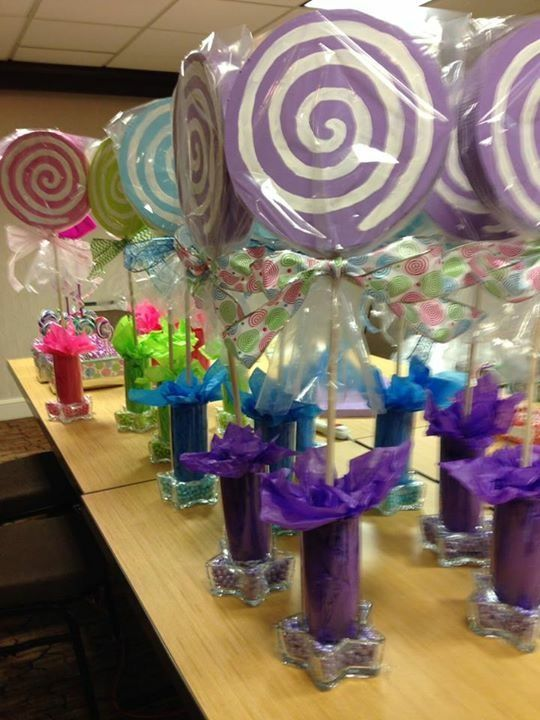 Styrofoam lollipop centerpieces with matching sixlet candies in start votives.