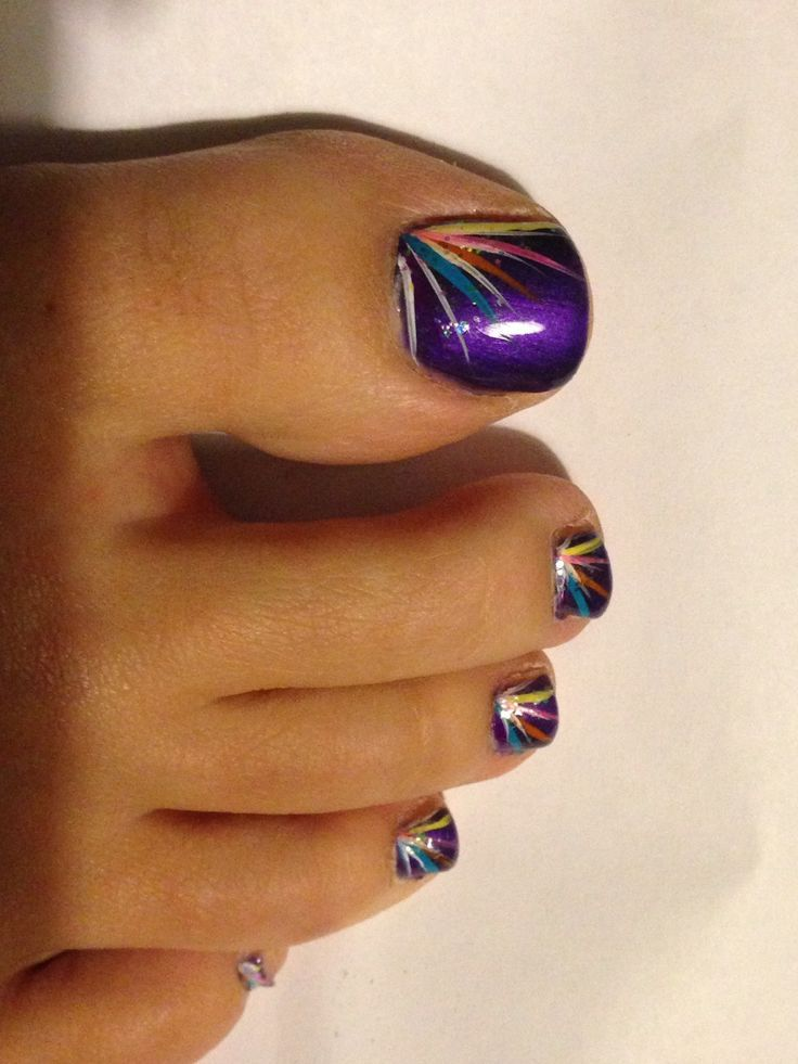This is a simple pedicure. Main color is purple. Also there is a different colors leafs painted on the nails.