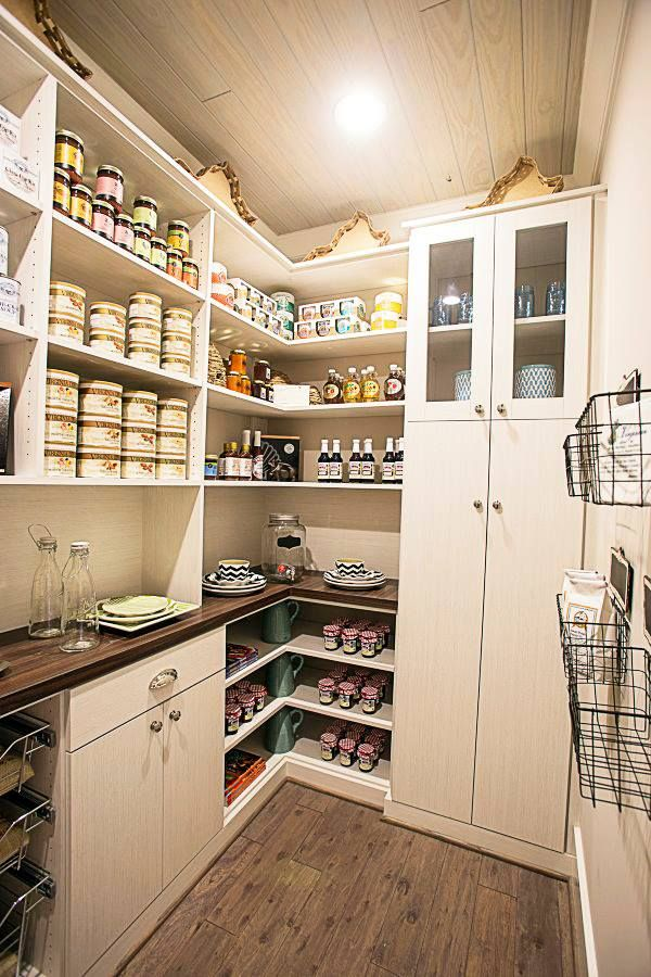 While Angled Shelves, Wired Baskets U0026 Glass Framed Cabinets Create A More  Functional Pantry