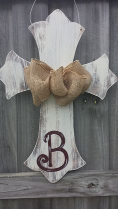 Painted wooden Cross Door Hanger with ribbon and personalized initial.