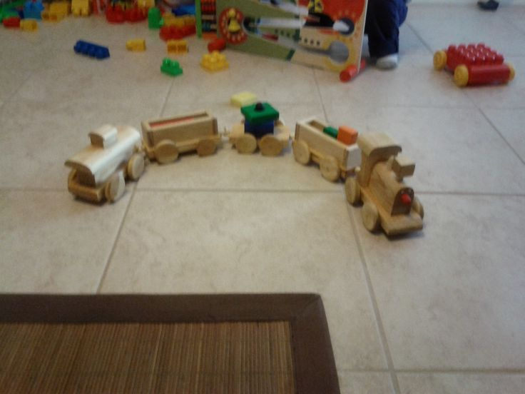 Made this wooden train set with a scroll saw.