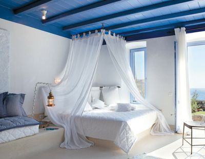 Bright Blue Greek decor style has drama, is simple & uncluttered, with the main colors being white and blue. And contrast creates drama! Window frames are painted bright blue throughout. Something we don't see very often.