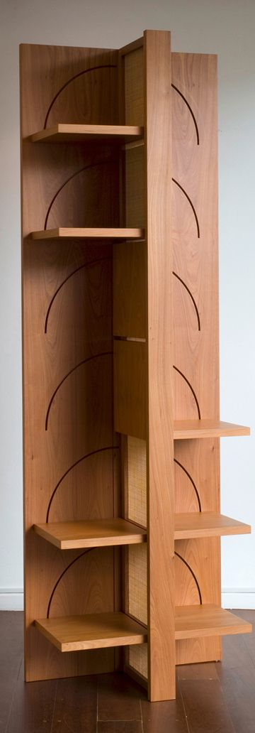 """""""Bedouin is an elegantly designed bookshelf that can be transformed into a compact, easy-to-transport piece of luggage. It is operated by interactive movements: like a book that is opened, the shelves unfold to become a bookshelf. It is supported by a hollow centre axis, which also serves for ventilation. Etel Marcenaria"""""""