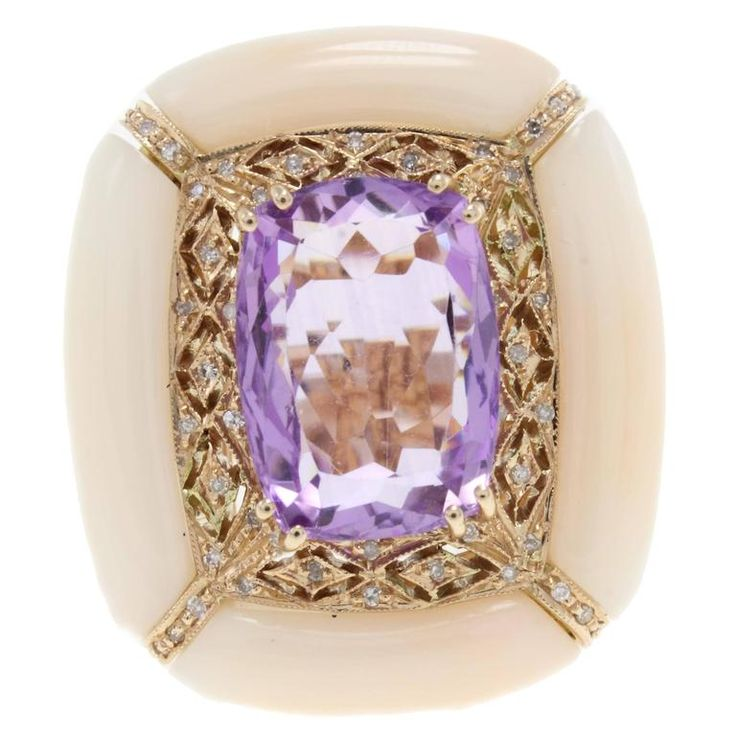 Luise Amethyst Pink Coral Diamond Gold Ring | Graceful and shapely is the shape of this ring, all mounted on14kt yellow gold, the shining amethist (9.08Kt) is the centre of a rectangular ring, with a frame of pink coral(4.40gr) adorned with diamonds (0.21Kt). Tot. weigth 16.3gr From a unique collection of vintage cluster rings at https://www.1stdibs.com/jewelry/rings/cluster-rings/