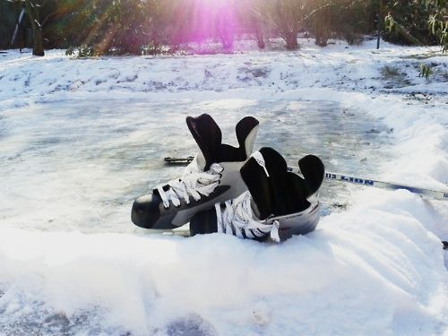 Hockey skates in the snow...a beautiful sight.