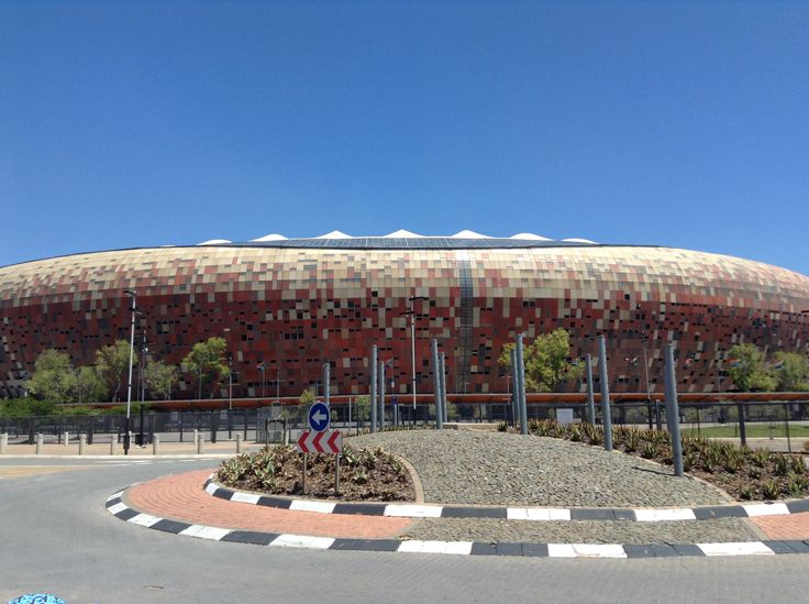 The FNB stadium where the world cup was held and also where Nelson Mandela gave a speech after being let out of jail.