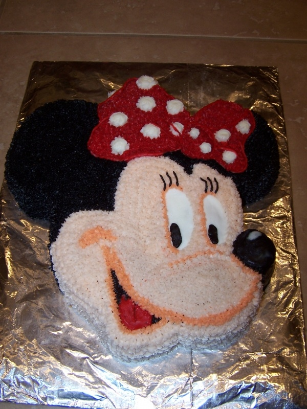 Minnie Mouse cake made out of a Mickey Mouse Wilton cake from 1980!