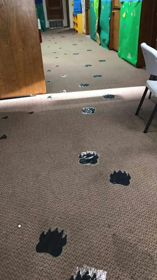 VBS camp out theme Bear tracks and deer tracks cut out and taped to floor