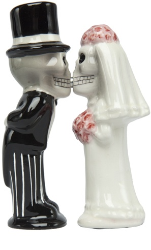 """LOVE NEVER DIES SHAKERS    Well looks like these two are together even in death! This ceramic salt & pepper shaker features on skeleton groom, a skeleton bride & are held in place by a pair of magnets.  4 1/2"""" tall    $10.00Salts Peppers Shakers, Love Never Die, Shakers Features, Salt Pepper Shakers, Ceramics Salts, Die Shakers, Salts Shakers, Die Salts, Cake Toppers"""