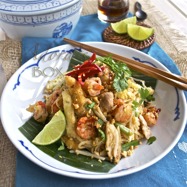 CHICKEN AND PRAWN PAD THAI 200 gms. of dry flat thin rice sticks 1 onion, chopped 4 cloves of garlic, crushed 1/2  of red chilli, chopped juice of 1 lime 1/4 c. demerara sugar 2 1/2 tbsps.  fish sauce 5 tbsps. cooking oil 3 large cloves garlic, crushed (1 tbsp.) 1 onion, thinly sliced 1 small chicken breast, sliced thinly 3 eggs, lightly beaten 3 bunches of spring onions,  1 tsp. light soy sauce 20 medium sized, peeled uncooked prawns 1/2 c. bean sprouts 1/4 c. chopped peanuts