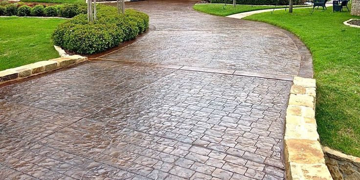 Check out this gorgeous stamped concrete driveway from  DRMP Concrete & Masonry. Call (952) 955-3378 for a free estimate today.