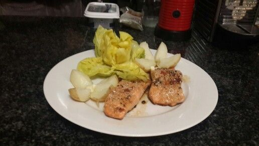 Pan fried salmon with a soya sauce, caramelised onion, sweet chilly, and sesame seeds.  Served with boiled cabbage quatered like a flower with butter, and boiled potatoes.