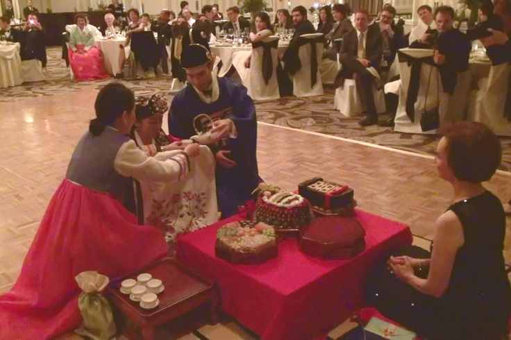 The couple serves tea to the groom's parents (in this case, his mother). When tea is shared, the bride is officially accepted into the groom's family. http://www.discjockey.org/
