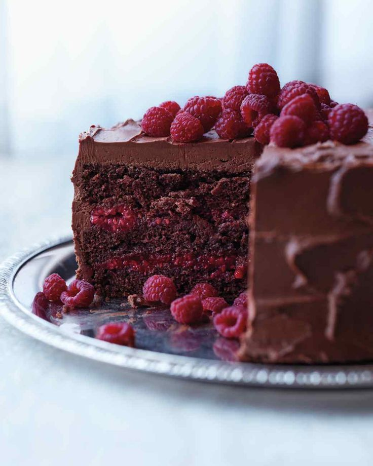 Chocolate-Raspberry Cake---This beauty is baked with a splash of Chambord and layered with a sweet raspberry filling, both of which offer bright counterpoints to the thick layer of chocolate-cream cheese frosting and whole berries scattered on top