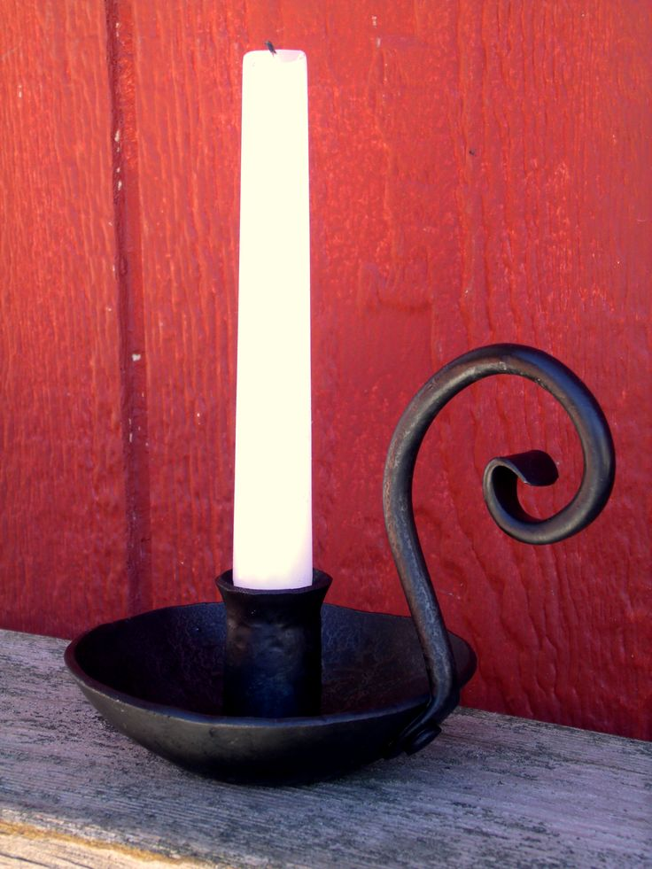 Primitive wrought iron candle holder made by Furnace Brook Iron Works