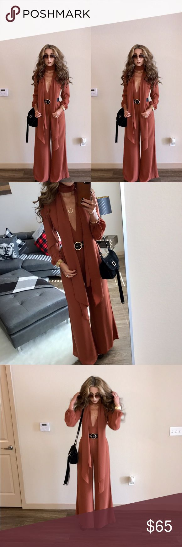 Last call neiman Marcus orange jump suit w/ scarf Last call neiman Marcus orange jumpsuit with matching scarf size small only worn once and dry cleaned like new very cute! Belt not included. last call neiman marcus Other
