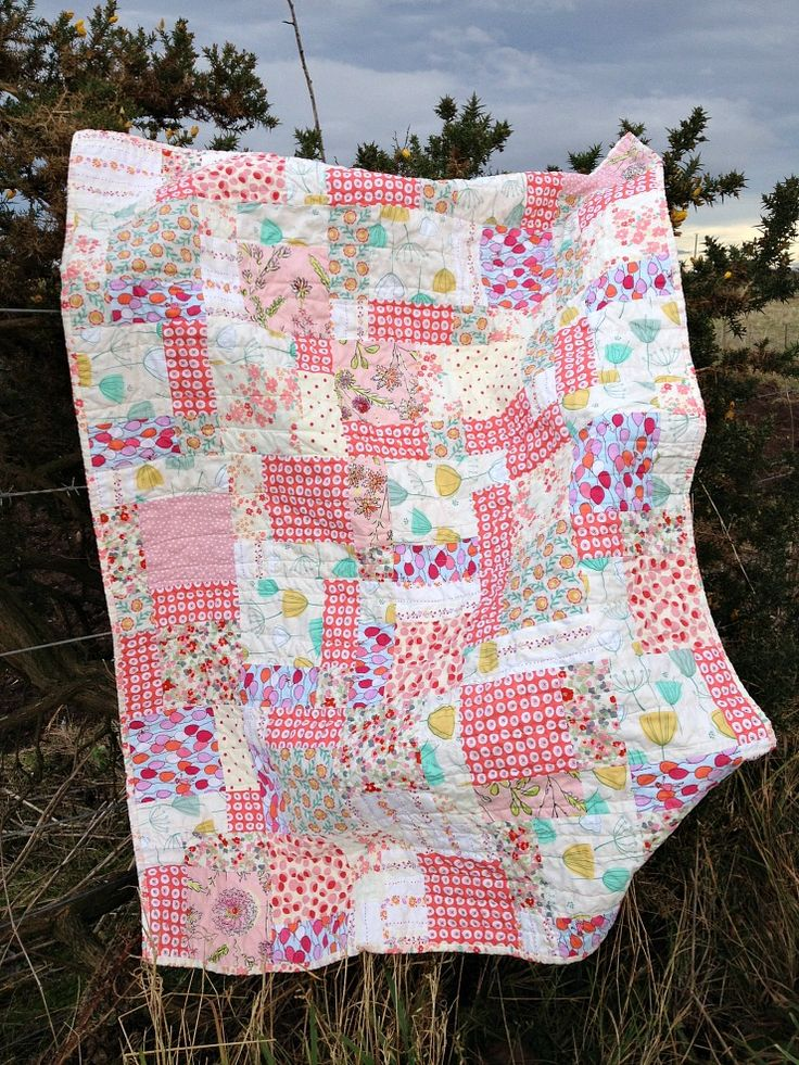 Summer Sunset, a disappearing nine patch baby quilt by Forest Poppy in pretty pink, red, yellow, green and orange