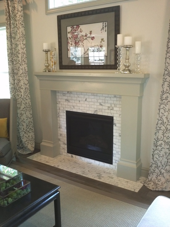like the light grey on woodwork and tile carrara white subway tile fireplace surround found at contempo tile