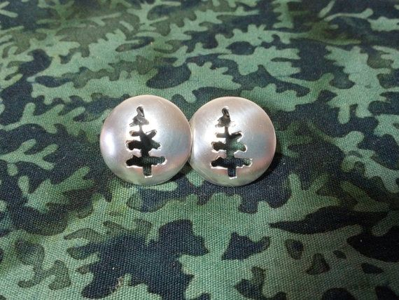 "Spruce Tree stud earrings by SlashpileDesigns on Etsy, $60.00  These stud earrings are 100% handmade. The tree silhouette is pierced from a silver dome and soldered sterling silver posts. Each earring is 5/8"" in diameter."