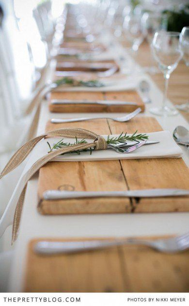 Elegant stemware, white linens, rustic plank placemats, burlap ribbon, rosemary sprig