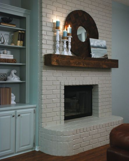 LOVE the dark wood mantle    For Lisa: Paint the brick fireplace white and the mantel a dark color so it'll pop. Also need to paint the gold on the cover, maybe black like this picture?