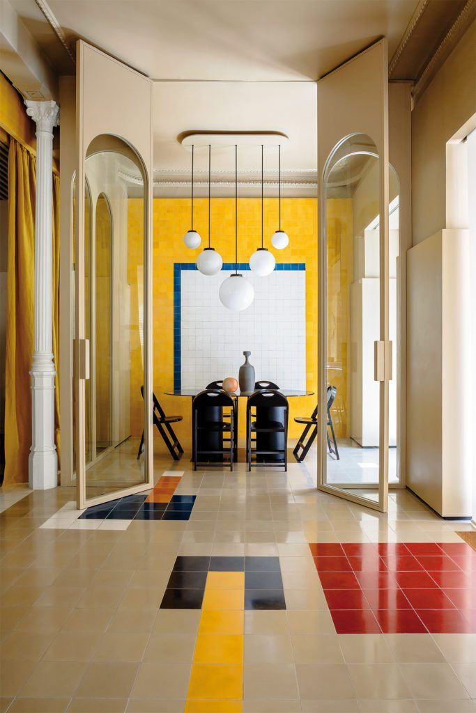 Madrid, Casa Josephine, M. Hyde agency, interior design by Inigo and Rogrigo Aragon, by Huskdesignblog | interior design trends | 80s interior style | yellow wall | yellow tiles | red tiles | black tiles | beige tiles | decorative arches | orned pillars | pillars of architecture | Spanish design | Spanish architect | surrealism | surrealist interior | colorful interiors | workspace | beige walls | beige ceiling | black chairs | meeting room | trompe l'oeil effect | yellow curtains glass wall