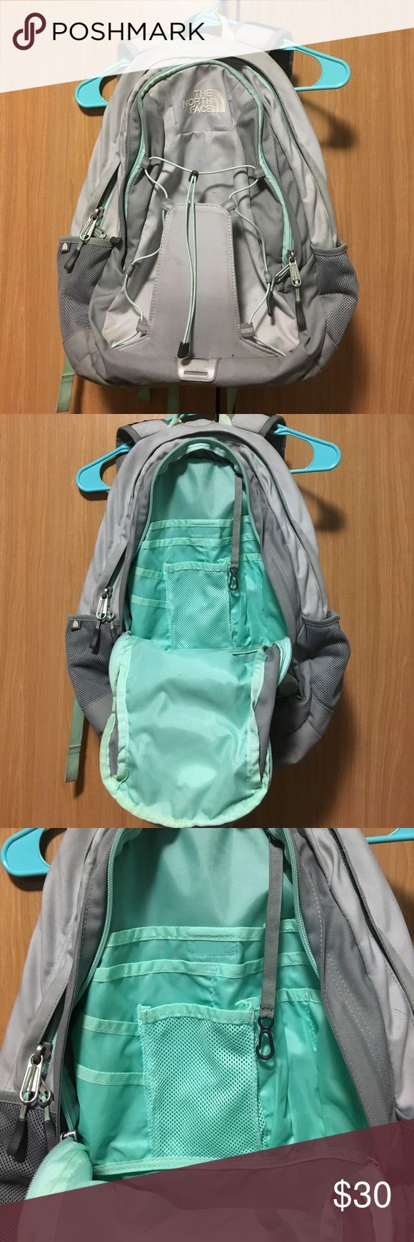 The North Face Jester backpack The North Face Jester back pack in mint/gray colors. This backpack has two bottle pockets on each side, a laptop pocket on the inside, another zip compartment full of smaller pockets, and bungee cords on the front. The inside does have ink stains from pens and the mint straps are a bit discolored. Other than those couple things the backpack is in very good condition. Asking $40 or best offer. The North Face Bags Backpacks
