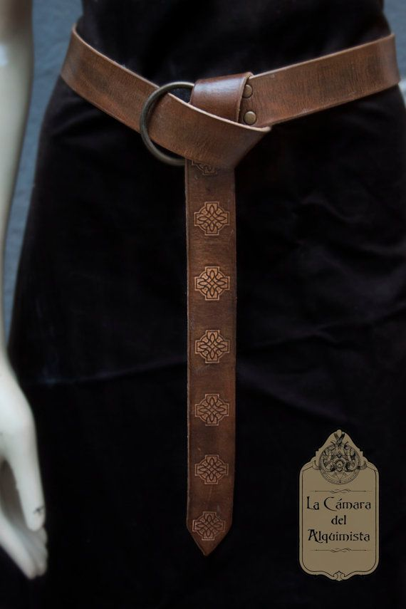 Handmade medieval inspired leather belt, decorated with celtic designs. Pilling and dyed to create a more realistic weathering effect.