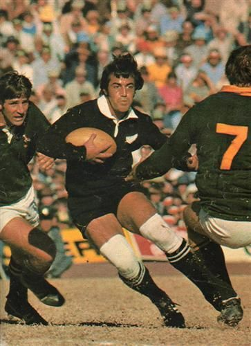 '76 - Second test - The McLook rugby collection It was a hard and intense match in which no quarter was asked or given. The picture shows Bryan Williams being boxed in by Boland Coetzee and Theuns Stofberg