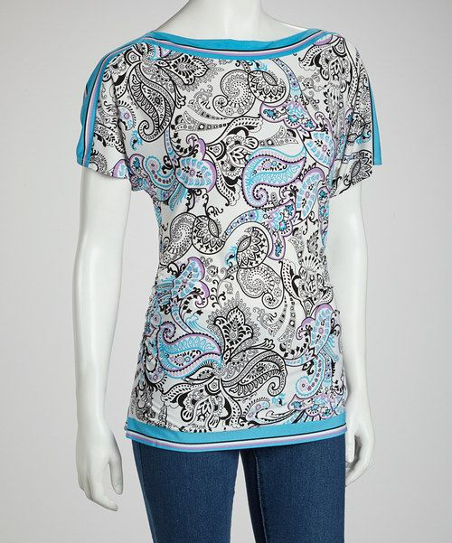 A stylishly eclectic presentation of colors and designs artfully combines to create a boatneck top that's weekday-to-weekend friendly.Measurements (size M): 26'' long from high point of shoulder to hem95% polyester / 5% spandexMachine wash; tumble dryImported