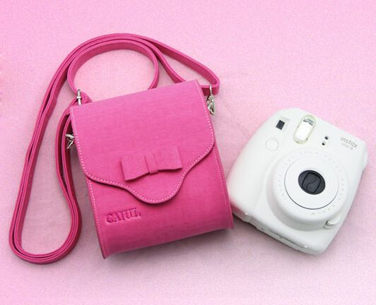 http://www.amazon.com/CAIUL-Universal-Magnetic-Smartphone-PIC-300P-Pink/dp/B00MHDU03K/ref=aag_m_pw_dp?ie=UTF8&m=AGUXB5JTSL9IS   CAIUL Universal Travel Case Bag With Magnetic Closure and Strap For Fujifilm Instax Mini 7s, Mini 8, Mini 25, Mini 50s, Mini 90 instant cameras/Fujifilm Instax Share Smartphone Printer SP-1/Polaroid PIC-300P-----Pink