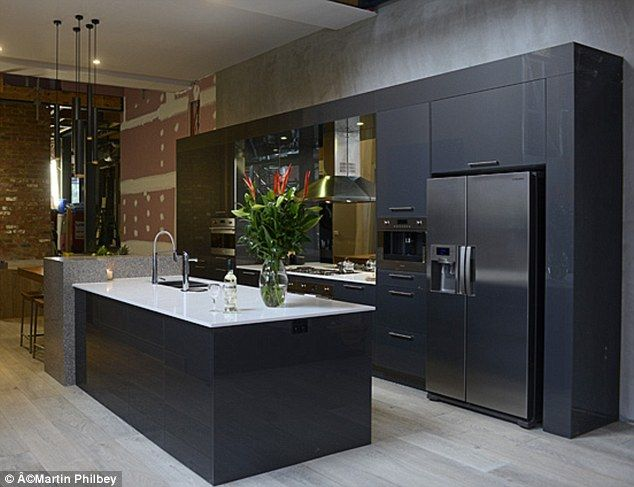 Black kitchen white bench top, mirror splashback,