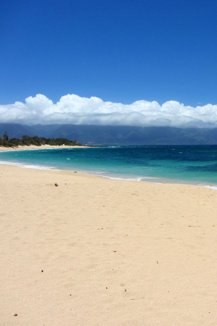 Maui Hawaii with it's multitudes of beaches and lava rock terrain is a Polynesian jewel. Beautiful photos and the history of the tropical paradise of Maui are included.