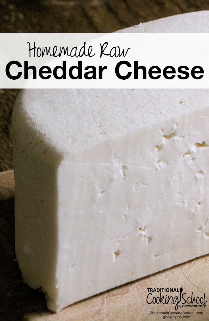 Homemade Raw Cheddar Cheese | They say this cheddar gets better with age. I don't know about that because we ate this homemade raw cheddar cheese fresh. For those of you without a cheese press, you can eat the curds fresh and un-pressed! | TraditionalCookingSchool.com