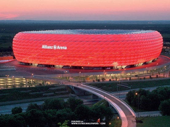 Allianz Arena. Munich, Germany.  Herzog and de Meuron's steel and concrete arena was the crown jewel of the 2006 FIFA World Cup. Today it packs in 69,000 fans for Bayern München and 1860 Munich soccer matches.