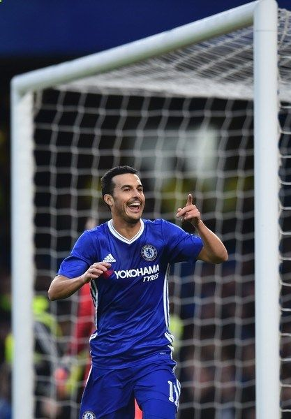 Chelseas Spanish midfielder Pedro celebrates scoring the opening goal during the English FA Cup third round football match between Chelsea and Peterborough at Stamford Bridge in London on January 8, 2017. / AFP / Glyn KIRK / RESTRICTED TO EDITORIAL USE. No use with unauthorized audio, video, data, fixture lists, club/league logos or live services. Online in-match use limited to 75 images, no video emulation. No use in betting, games or single club/league/player publications. /