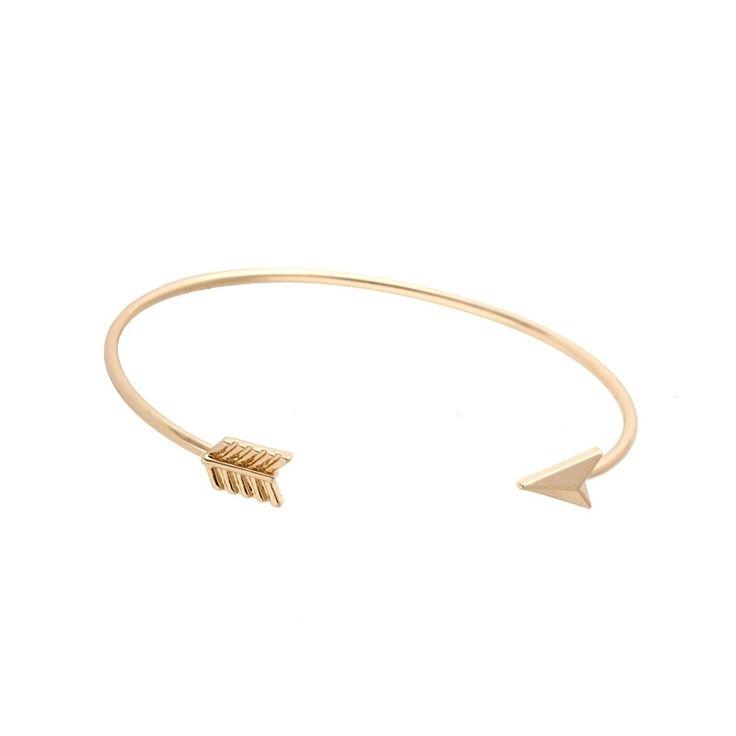 Bracelet flèche en métal doré plaqué or 9k et strass. Un bracelet fantaisie tendance 2017 . Bracelet réglable convient à tous les poignets.Ce bracelet tendancea tout ce qu'il lui faut pour devenir l'accessoire incontournable de la saison! Profitez de bracelet à prix mini!  Emballage cadeau offert!