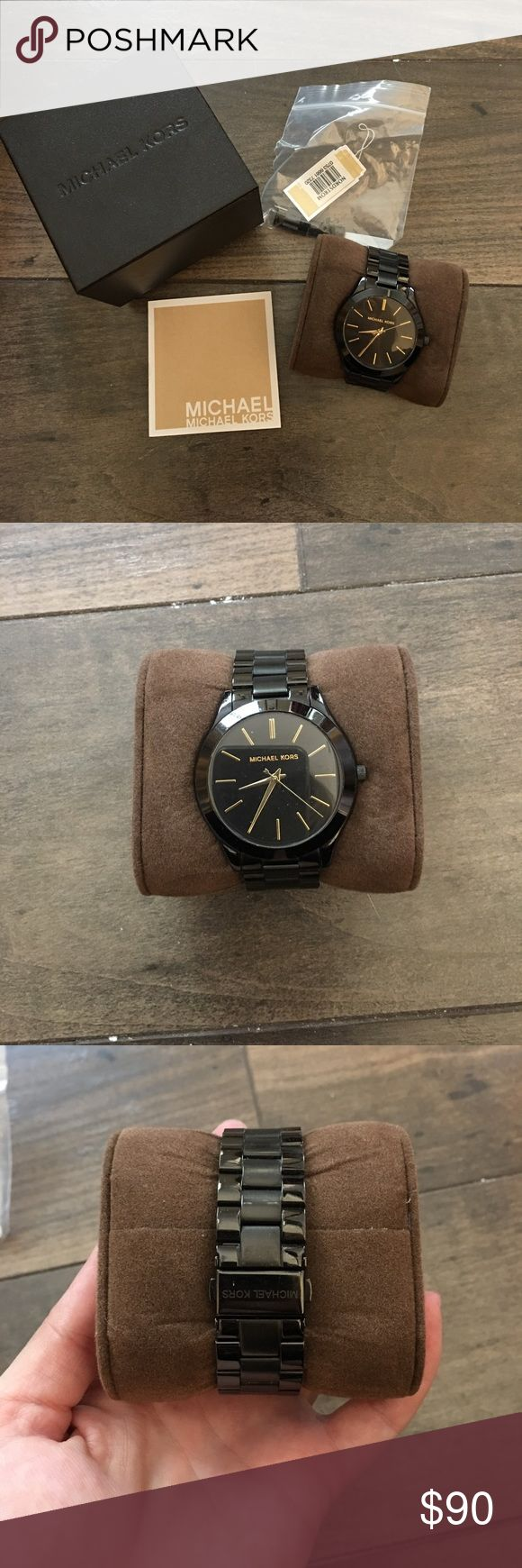 Black Michael Kors Watch Black watch with a round face. Just a few marks on the under side! MICHAEL Michael Kors Accessories Watches