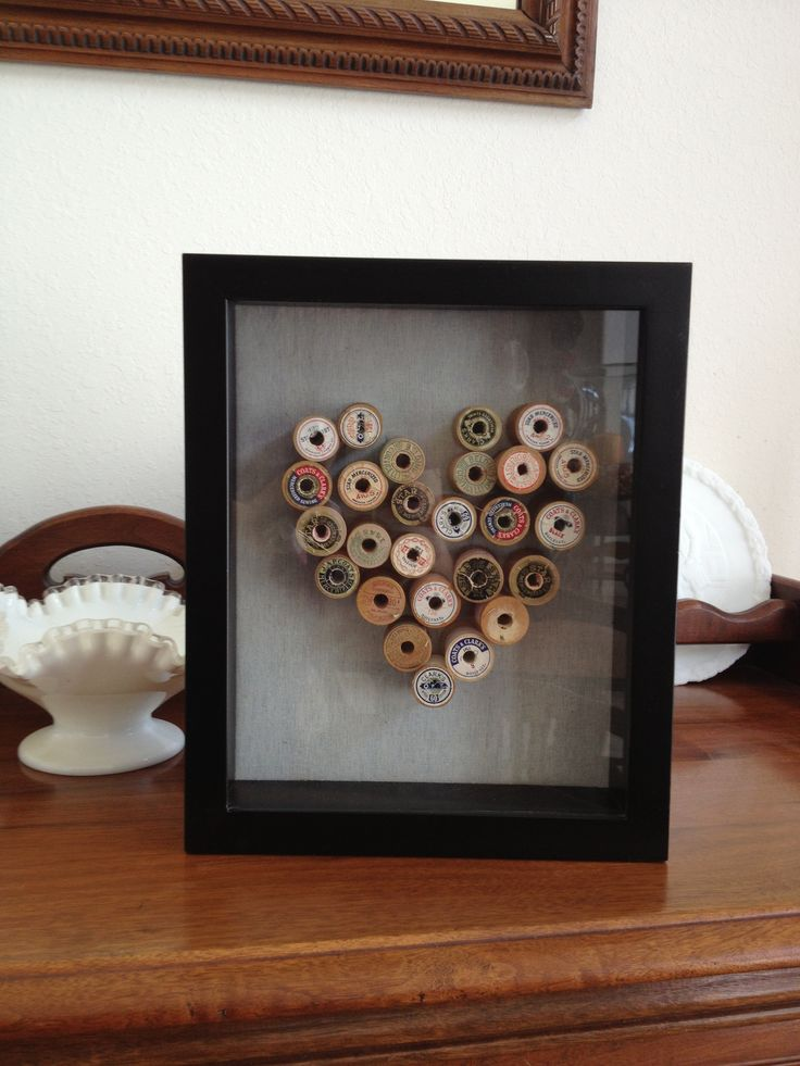 Wooden spools of thread in a shadow box for Mom's craft room.