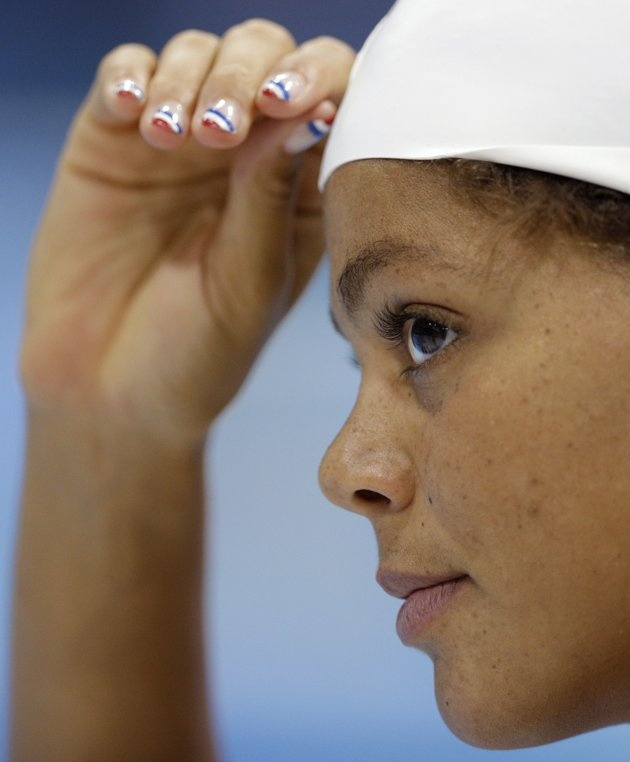 Coralie Balmy– France–Swimming  J Coralie Balmy of France wears nail polish in the colors of the French flag as she trains at the Aquatics Center at the Olympic Park ahead of the 2012 Summer Olympics, Wednesday, July 25, 2012, in London. Opening ceremonies for the 2012 London Olympics will be held Friday, July 27