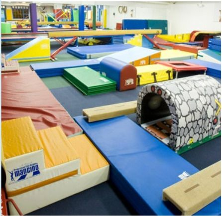 Children's gym in Glenwood's Caldwell building features colorful crawling, climbing, and jumping foam playmates
