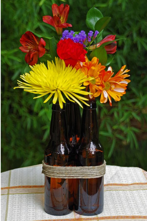 Drop fresh flowers into your empty Coors Light bottles—the amber glass easily warms up any space. Get the how-to from Suburbia Unwrapped.