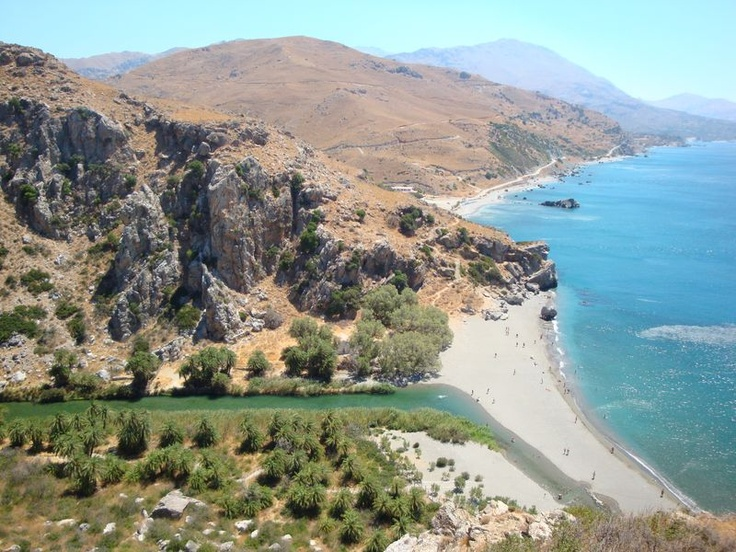 View on the Palm Beach - In other words, Finikas beach (φοινικόδασος). There is striking contrast of green and blue water where the river Megalos Potamos falls into the Libyan sea and where the Kourtaliotiko gorge (Κουρταλιώτικο φαράγγι) ends.