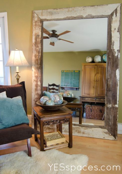 Leaning mirror with reclaimed pieces - check Habitat ReStore for discarded large mirrors?